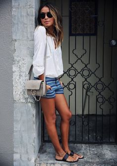 Striped shorts, loose cotton top. | Summer Street Style | A la Plage. | via bloglovin.com