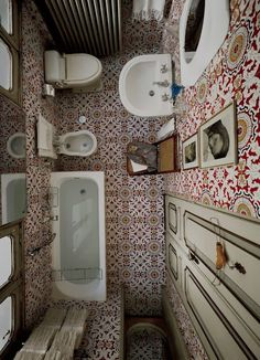 So much going on in this small but beautiful bathroom. The patterned tiles on the floors and walls look fabulous.