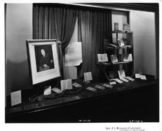 """""""Life of an American Workman,"""" by Walter P. Chrysler. An image of Chrysler is affixed to the rear of the display, signage adjacent to the image and surrounded by velvet drapes reads, """"Life of an American Workman, by Walter P. Chrysler in collaboration with Boyden Sparkes, An Informal Biography of one of the Head of America's Greatest Industries, Book Shop, Mezzanine Gratiot, Section C."""""""