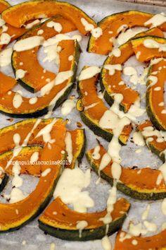 Roasted Pumpkin with a Lemon-Tahini Dressing (2tbsp lemon juice, 1tbsp tahini, 1tbsp olive oil, 1 tbsp water, salt) - Zucca al forno condita con semi di cumino e una salsina a base di 2cc di succo di limone, 1 di tahini (la salsa di sesamo mediorientale), 1 di olio evo, 1 di acqua e sale.
