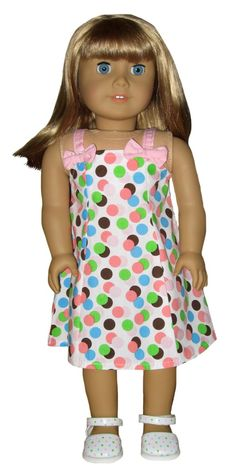 The white dress has pink, blue, brown, and green dots and pink bows. Sold by Silly Monkey Doll Clothes http://www.silly-monkey.com/dresses.htm