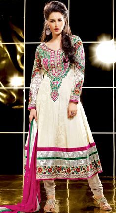 The glamorous silhouette to meet your most dire fashion needs.   The dazzling off white crepe jacquard anarkali churidar suit have amazing embroidery patch work is done with resham, zari, sequins, stone and lace work.   Beautiful embroidery work on kameez is stunning.   The entire ensemble makes an excellent wear.   Matching santoon churidar and pink chiffon dupatta is available with this suit.   Slight Color variations are possible due to differing screen and photograph resolutions.