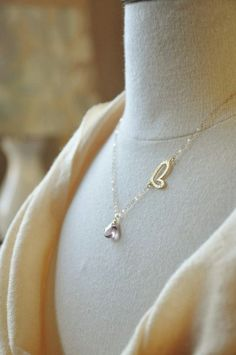 Gold heart asymmetrical necklace, pink mystic quartz, gemstone necklace, baby pink color, unique design, love, anniversary gift, bridesmaids gifts, custom stone, gold filled chain  This beautiful asymmetrical necklace features a heart and a sparkly baby pink mystic quartz gemstone. They are suspended on a delicate shimmering 14K gold filled chain. This unique necklace can be dressed up or down. Please let me know if you would like to substitute the stone with a different colored stone…