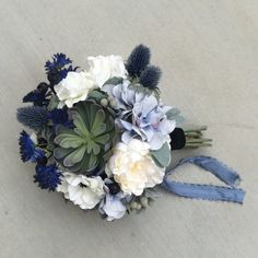 Loving this bouquet! Plus, it'll be a keepsake after the wedding day! Succulent Blue & White Silk Wedding Bouquet with Peony, Hydrangea, Cornflower, Anemone, Thistle, Echeveria, Blueberry by fleurdunord on Etsy https://www.etsy.com/listing/243757635/succulent-blue-white-silk-wedding