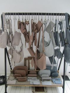 Hang bar and hooks for craft show display. lots of product but the display still looks tidy because of minimal colour and patterns Market Displays, Craft Show Displays, Store Displays, Visual Display, Display Design, Display Ideas, Shop Interior Design, Retail Design, Handbag Display