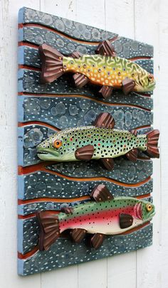 "New to Rachel Laundon Art this stunning artwork features smaller versions of RLA's Brook Trout, Brown Trout, and Rainbow Trout mounted to an 18 "" wooden abstract river relief in blue and orange cr Metal Fish, Wooden Fish, Wooden Wall Art, Fish Wall Art, Fish Art, Folk Art Fish, Driftwood Fish, Fish Sculpture, Fish Crafts"