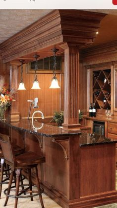 Basement bar - love how they covered the posts and pretty supports for counter top