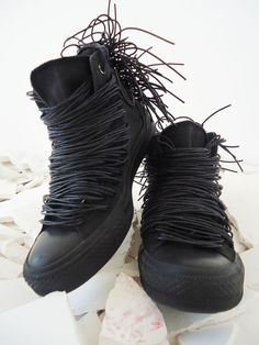 Black Converse sneakers painted and decorated with faux leather, rubber cords, handmade rubber meshwork at the back with mat end, and added shoe-laces. (da style that rocks, tumblr)