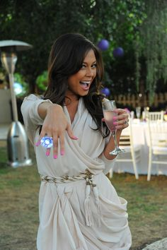 Holding a glass of a signature lilac-infused Hpnotiq Harmonie cocktail, Vanessa Minnillo celebrates her bridal shower outdoors and showcases her pink manicure while posing with an oversized diamond-shaped cocktail ring. Photography: Angela Weiss for WireImage. Read More: http://www.insideweddings.com/weddings/vanessa-minnillo-and-nick-lachey/486/