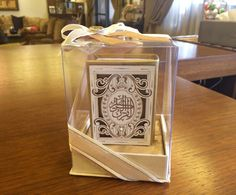 Looking for Hajj or Eid gifts? Offer a mini Qur'an to your guests, packaged beautifully in a see-through casing with an elegant beige and gold ribbon.