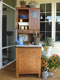 small apartment size Hoosier with vintage garden collectibles