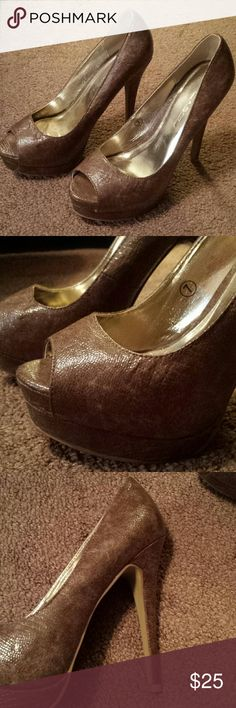 Brown stilettos Size 7. 5in heel. Brown peep toe pumps have a snake skin like print. Got from Just Fab Shoes Heels
