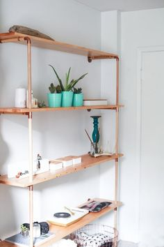 Books are a glorious albatross around the neck of any literature lover. All those hard copies are a pain to move and store, but at the same time, it's sooooo hard to give them up. If you choose to display all your beautiful burdens, consider making one of these do-able DIY shelving systems.