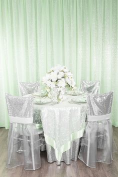 Glam silver sequin and mint green wedding/event tablescape