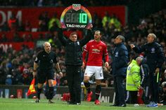 A fourth official displays LED board with rainbow colours during the Premier League match between Manchester United and Brighton and Hove Albion at Old Trafford on November 25, 2017 in Manchester, England.