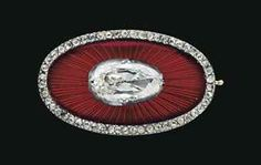A JEWELED GOLD AND GUILLOCHÉ ENAMEL BROOCH BY FABERGÉ, WORKMASTER'S MARK OF AUGUST HOLLMING, CIRCA 1900  Oval, the body enameled in translucent red over a sunburst guilloché ground, centering an oval rose-cut diamond, within a rose-cut diamond border, the reverse with mounted pin.