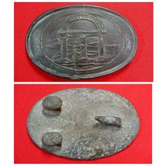 A very attractive, excavated, large size, lead-filled, Georgia State Seal oval waist belt plate.  This extremely rare Confederate buckle is out of the nationally known Charlie Harris collection and was originally recovered by Dr. Rees Buttram on private property near Chickamauga.  The face has a nice brown/green patina with crisp detail.  This rare buckle has the distinction of having been in two of the finest nationally known excavated artifact collections in existence.