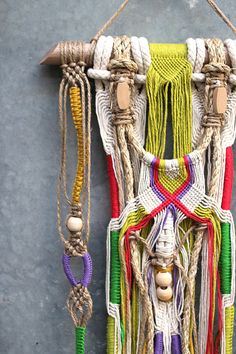 ANJARE   Unique wall hanging macrame with tassels & raw timber beads very refreshing and vivid combines natural tones with bright colours and has beautiful details   size: approx. 270 x 900 mm (wall hanging itself, without the dowel) colours : jute, mustard yellow, lime green, grass green, orangered, purple  wall hangings are an amazing home decor they immediately transform your room  I love the atmosphere they create!  Free shipping within Australia.
