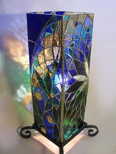 Stained Glass Lantern (note the holder at the bottom) Stained Glass Light, Stained Glass Designs, Stained Glass Panels, Stained Glass Projects, Stained Glass Patterns, Leaded Glass, Mosaic Glass, Glass Painting Designs, Glass Artwork