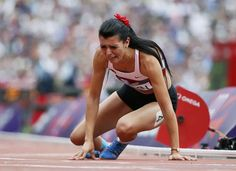 Turkey's Merve Aydin cries after she came in last in her women's 800m round 1 heat at the London 2012 Olympic Games.