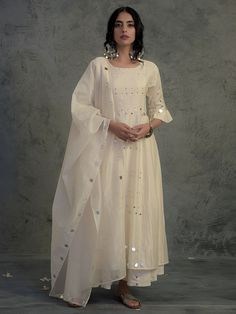 Ivory chanderi kurta set with pleated mirror embellished sleeves and mirror work on front panel. Look for the Ivory Chanderi Pleated… Pakistani Fashion Casual, Pakistani Dresses Casual, Pakistani Dress Design, Indian Fashion, Indian Gowns, Indian Attire, Indian Wear, Indian Wedding Outfits, Indian Outfits