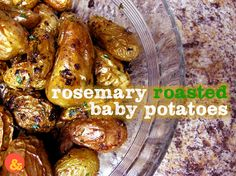 Rosemary Roasted Baby Potatoes: Crispy and salty little roasted fingerling potatoes with chopped fresh rosemary, garlic and pepper!