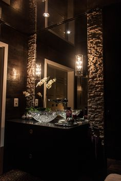 Perhaps too dark for me but I love the vanity, crackled glass basin and everything else.