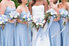 Pastel periwinkle blue bridesmaid dresses with pink and white wedding bouquets