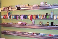 Craft room ribbon storage galvanized gutters - hey, it works in the garage along the front of my husband's work bench!