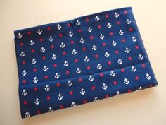 red stars and white anchors on navy vintage fabric