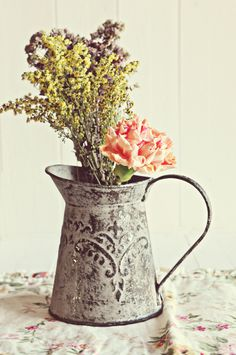 Love this antique pitcher as a vase!