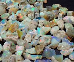 This listing is for ONE Opal raw stone from Ethiopia and will be chosen at random. Stones range from .25-.45gm, and sizes range from 8-15mm, so