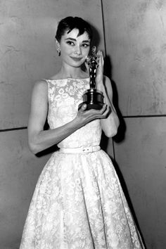 Love her brow style when she was young - Audrey Hepburn with her Oscar for Roman Holiday, 1954