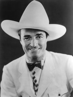 Tom Mix j (He had some great movies and could sing very well)