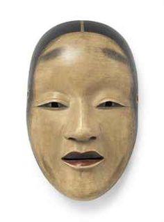 Noh mask of Shakumi 曲見(しゃくみ)目と長いえくぼに特徴の有る難しい面。