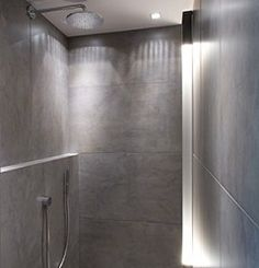 made to measure shower with integrated lightstrip (kreon dolma) and ceramic tiles 1200by600 mm; designed by Philip Theys