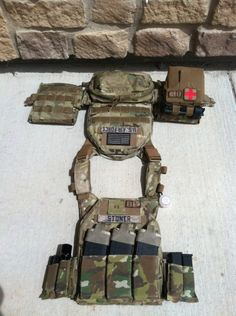 It is a Tactical Tailor FightLight plate carrier with medium ESAPI plates and small side plates. Three cell BFG tenspeed M4 pouch. Two two cell tenspeed pistol pouches on either side. The IFAK is a BFG trauma kit now with the tourney strap. Pouch on back is a BFG medium horizontal utility pouch for some loose odds and ends. All the multicam pouches are the new Helium Whisper kind. the IFAK is legacy MOLLE. Its set up for a stateside load of 120 rounds for primary and 45 rounds of secondary…