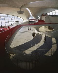 Look at the way the oval openings frame the space and echo the railings... TWA Terminal by Eero Saarinen