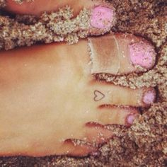 Small heart tattoo - toe tattoo. (*The band-aid's weird. Maybe they should've taken the photo on a different day.)