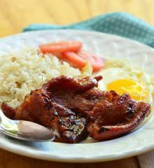 Pork Tocino is a traditional Filipino breakfast made with pork slices cured in salt, pepper, and garlic. Typically served with garlic fried rice and eggs, it's a truly scrumptious breakfast treat!