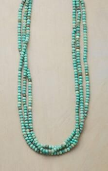 This handmade Australian opal necklace combines rich color with infinite glitter.