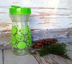 Check out this item in my Etsy shop https://www.etsy.com/listing/90392418/mod-retro-lime-transfer-ware-glass