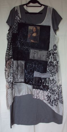 Tunic of open weave knit featuring image of Mona Lisa. Stenciling in grey/black on central panel of black cotton lawn. Tunic shown over simple grey jersey knit underdress. Pearl Red Moon 2013