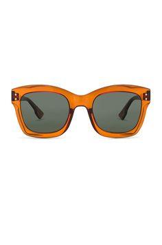 f5175497d6 Image 1 of Dior Izon  sunglasses in Orange  amp  Green Funky Glasses