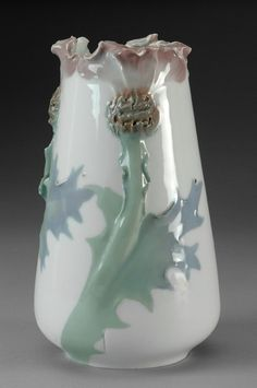 Karl Lindstrom. Under glazed ceramic. Hand painted decoration of flowering thisteles, in relief.. Signed Rörstrand KL impressed 4810 O.B
