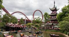 6. Tivoli Gardens s located in Copenhagen, Denmark is one of the oldest amusement parks that first opened in 1843. The park's first roller coaster Rutschebanen or, The Roller Coaster has a tract that wounds around a mountain. The modern Daemonen or, The Demon is a steel coaster that has floorless cars and a track that brings in all of the three of the park's coaster inversions. Wave Pool, Tivoli Gardens, Copenhagen Denmark, Dancing In The Rain, Water Slides, Amusement Parks, Garden S, Scary