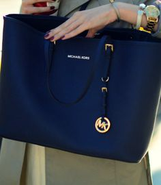I'm in love with Micheal Kors ♥ and I'm going to have it. soon ;)
