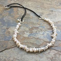 Bohemian White Keshi Pearl Necklace, Pearl necklace, Rustic Pearl Necklace, 19 inch ~ Boho Elegant! This necklace is handmade using creamy white keshi pearls that are attached to sterling silver hammered rings. The rings are attached to natural cotton cord and finished with a