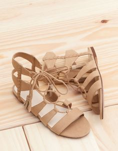 Strappy lace-up flat sandals. Discover this and many more items in Bershka with new products every week