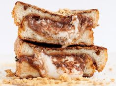 11 of the Craziest S'mores Combinations Ever | Mental Floss. Check out the innards of these Two pieces of French toast filling crammed with hot marshmallows, melted chocolate, and some graham cracker bits -YUM. Desserts #camping #recipes